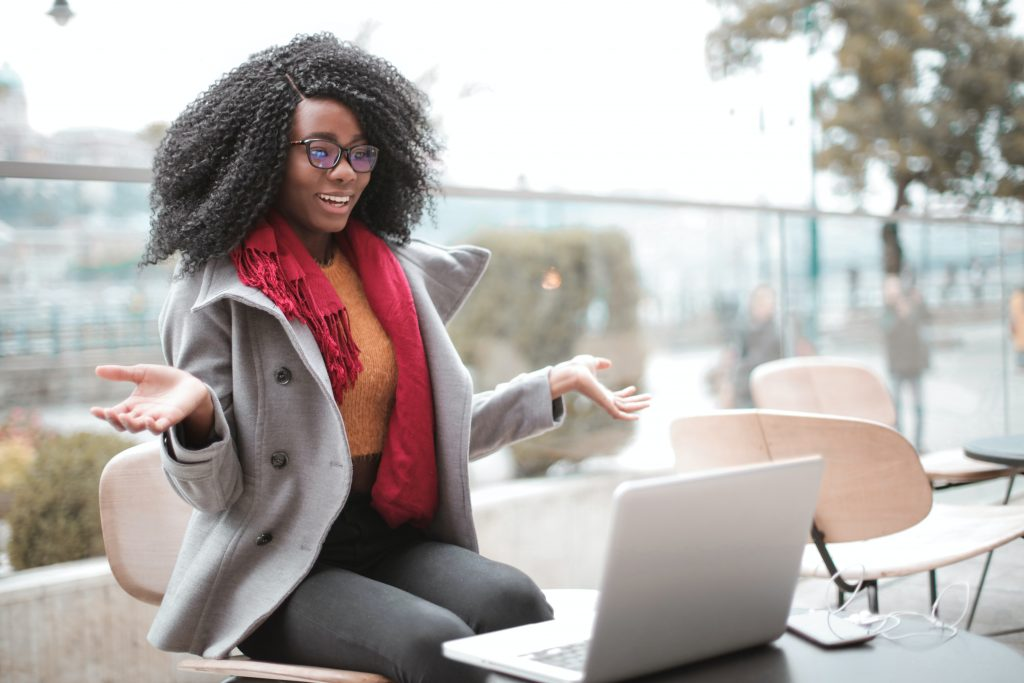 image of African woman sitting in front of her computer